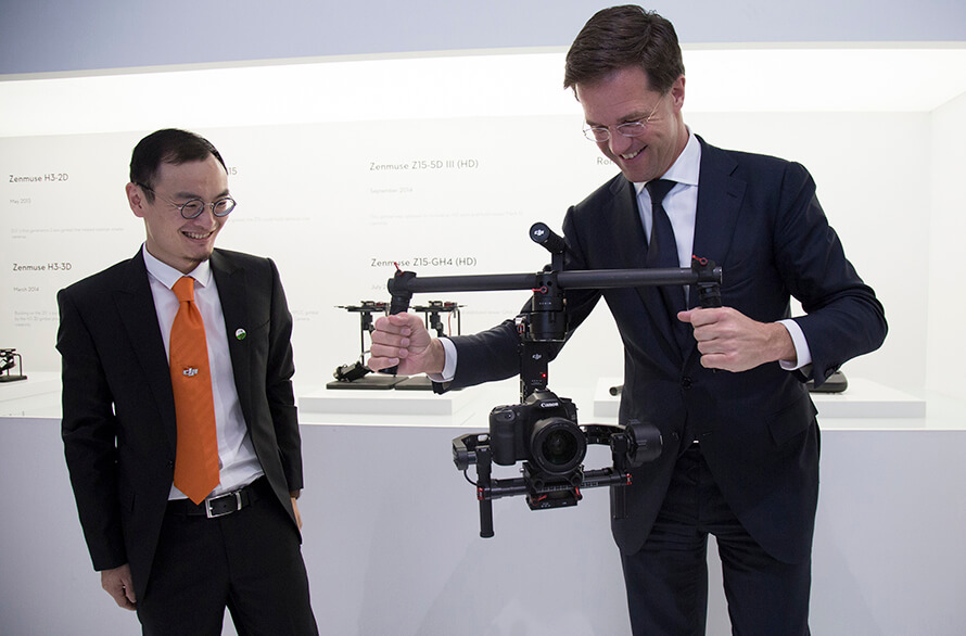 Mr Rutte Showed Great Interest In DJIs Product Line During His Visit He Even Tried Hand At The DJI Ronin 3 Axis Camera Stabilization Gimbal And
